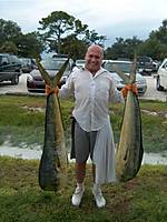 Joel_w_2_Dolphin_Bulls_caught_Aug_09.jpg